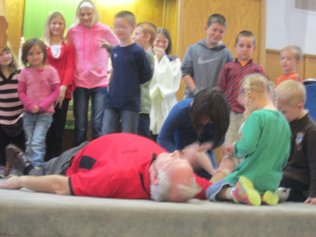 The kids help act out the Good Samaritan parable during Children's Worship Sunday.