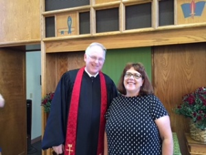 Pastor congratulated by Rev. Jane Anderson